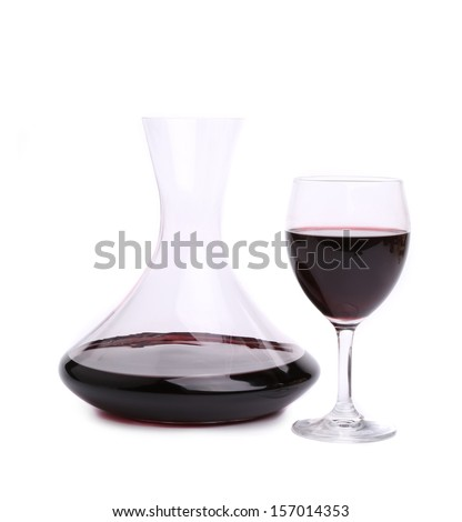 Decanter with red wine and glass of wine - stock photo