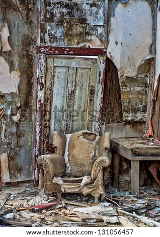 Decayed chair in an old cabin in Randsberg California - stock photo