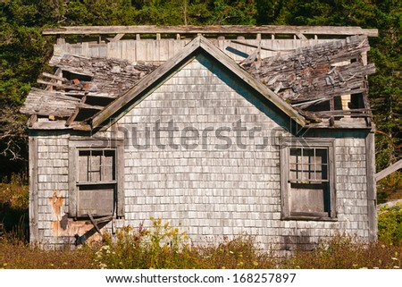Decaying and abandoned small rural house - stock photo
