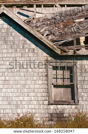 Decaying and abandoned small rural house detail - stock photo
