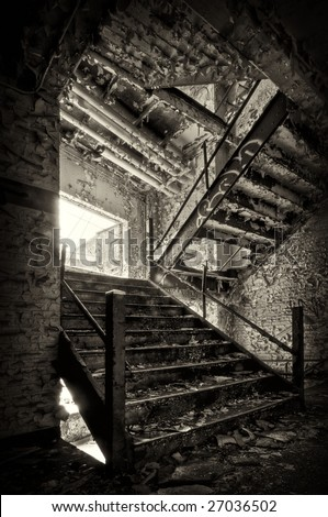 Decaying Stairwell in an Industrial Building - stock photo