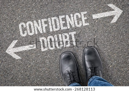 Decision at a crossroad - Confidence or Doubt - stock photo