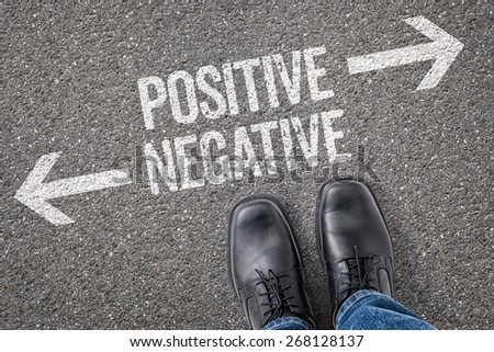 Decision at a crossroad - Positive or Negative - stock photo