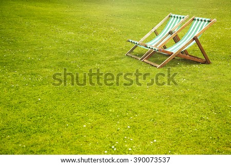 Deck chairs in the park - stock photo