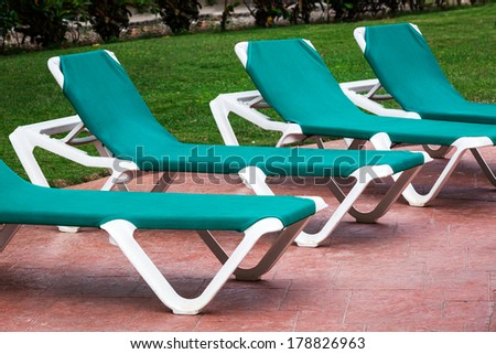 deck chairs on a cloudy day on the tile - stock photo