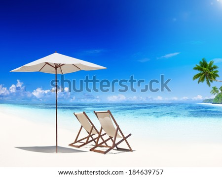 Deck Chairs on Tropical Beach - stock photo