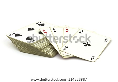 Deck of old playing cards with ace cards on top isolated on white background. - stock photo