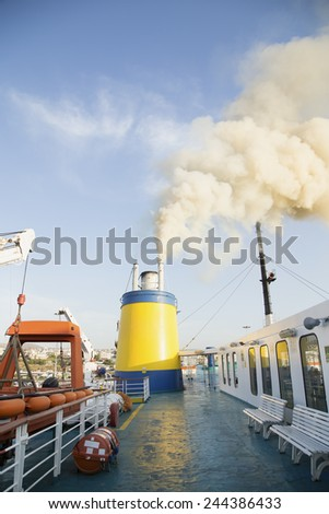 Deck on a catamaran ship with the smoke from the engine - stock photo