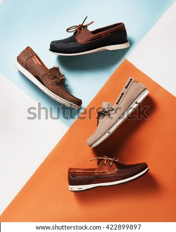 deck summer shoes in pan with a colorful  symmetric background with pastel colors - stock photo