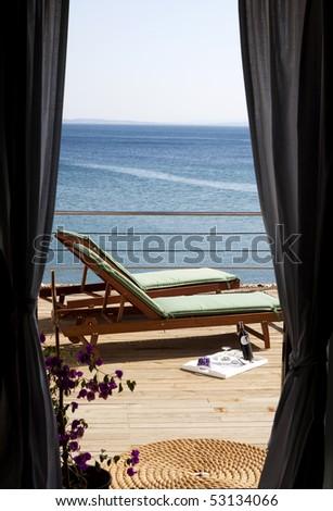 deckchair on hotel balcony - stock photo