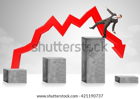 Declining chart, successful businessman turning into troubles - stock photo