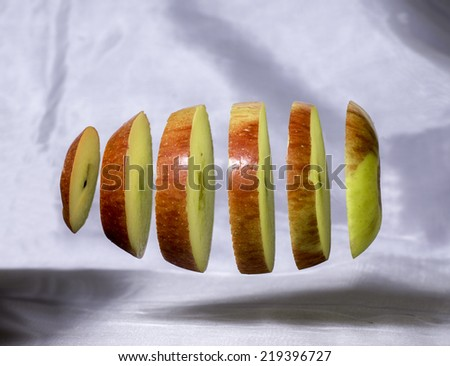 Deconstructed Floating Apple on Plain Background - Abstract Cool Still Life - stock photo