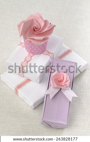 decor ideas gift wrapping rose origami boxes on white and lilac - stock photo