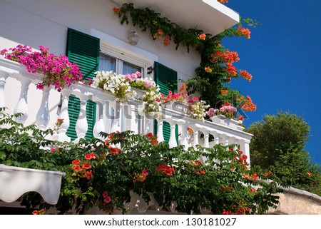 Decorated balcony, mediterranean climate flora and architecture - stock photo