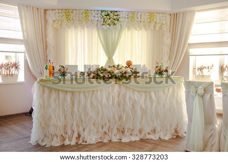 Decorated banquet wedding table with dishware waiting for bride and groom.  - stock photo