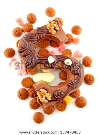 Decorated Chocolate letter S for Sinterklaas with ginger nuts, typical Dutch party in december, isolated on white background - stock photo
