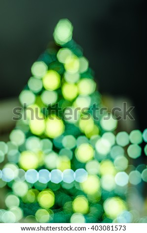 Decorated Christmas tree. Abstract blurred lights background - stock photo