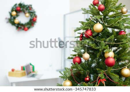 Decorated Christmas tree in office - stock photo