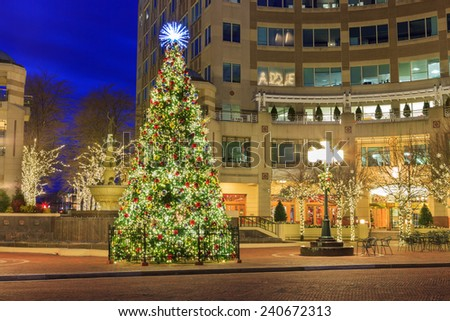 Decorated Christmas tree in outdoor plaza at Reston Town Center Virginia - stock photo