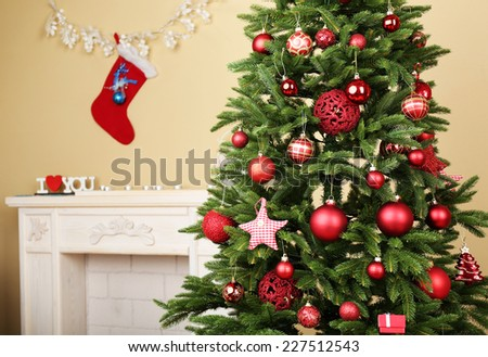 Decorated Christmas tree in room closeup - stock photo