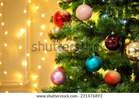 Decorated Christmas tree on blurred backgroun - stock photo