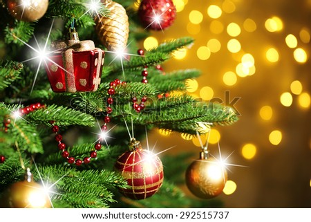 Decorated Christmas tree on lights background - stock photo