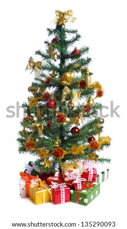 decorated Christmas tree with heap of gifts. isolated on white background - stock photo