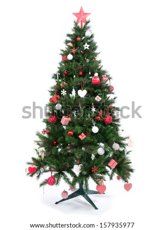 Decorated Christmas tree with ornate decorative balls, gifts red ribbons a seasonal symbol of winter celebration new year on a white background - stock photo
