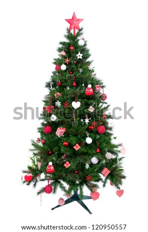 Decorated Christmas tree with patchwork ornament, artificial red star, hearts, hat and small presents for new year isolated on white background - stock photo
