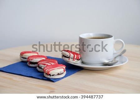 decorated cookies on table with napkin and white cup   - stock photo