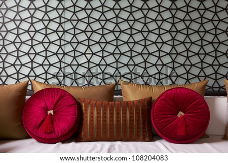 Decorated couch with fancy sofa pillow - stock photo