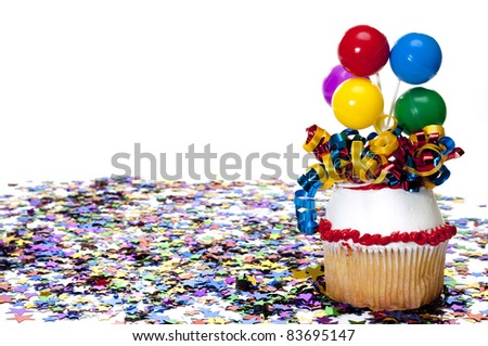 Decorated Cupcake and Confetti at Party - stock photo