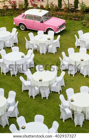 Decorated  dining table in the garden - stock photo