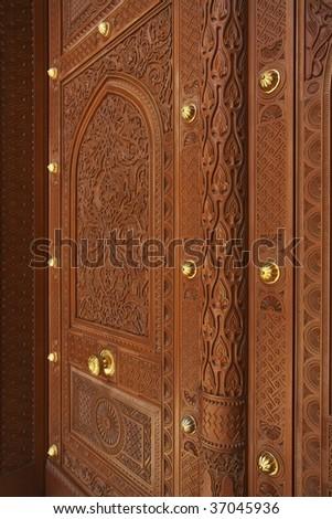 decorated door of grand mosque, Oman - stock photo
