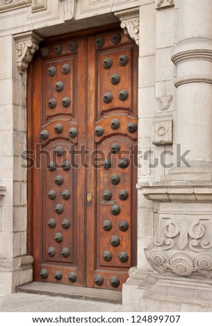 Decorated doors in the Archbishop's Palace on the Plaza Mayor (formerly known as the Plaza de Armas) in Lima, Peru - stock photo