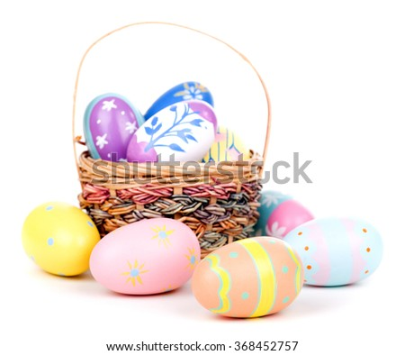 Decorated Easter eggs and basket on a white background - stock photo