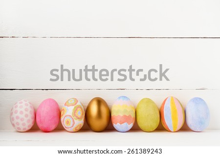 Decorated Easter eggs on white background with copy space - stock photo