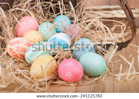 Decorated Easter eggs spilled from a basket - stock photo