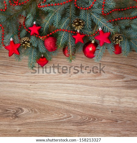 decorated fir tree border on wooden background - stock photo