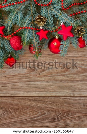 decorated fir tree border on wooden background, vertical shot - stock photo