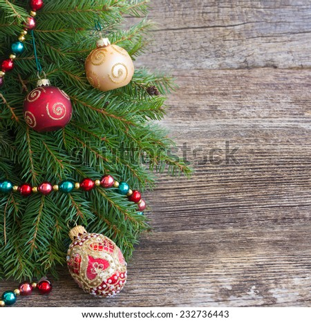 decorated fir tree spruice on wooden background with copy space - stock photo