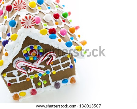 Decorated gingerbread house on white background. - stock photo