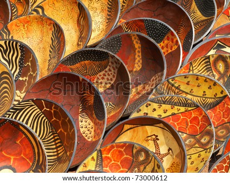 Decorated hand made wooden bowls carved from the wood of indigenous African trees - stock photo