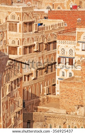 Decorated houses and palaces in the Old City of Sana'a, the oldest continuously inhabited and populated city in the world, Yemen, Unesco world heritage site with unique architectural characteristics - stock photo