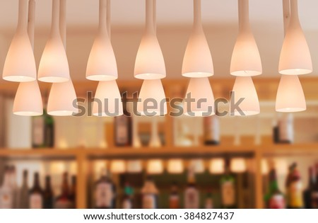 decorated lamp over on the counter bar in restaurant. - stock photo