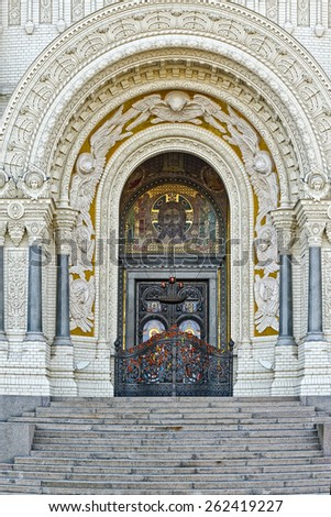 Decorated Main Gate of Naval Cathedral of Saint Nicholas in Kronstadt, near Saint-Petersburg, Russia - stock photo
