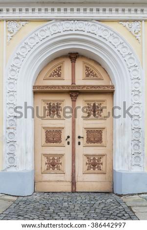 Decorated old door - stock photo