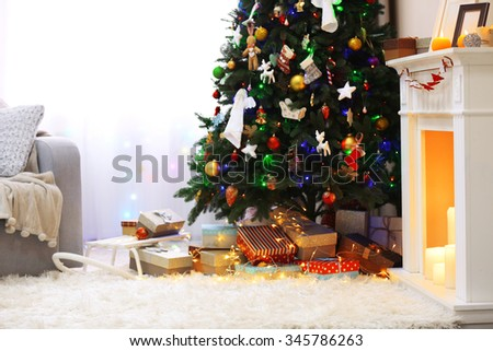 Decorated room with Christmas tree and presents under it, close up - stock photo