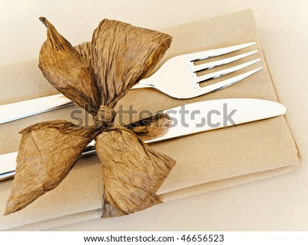 decorated table serving with golden bow in serviette - stock photo