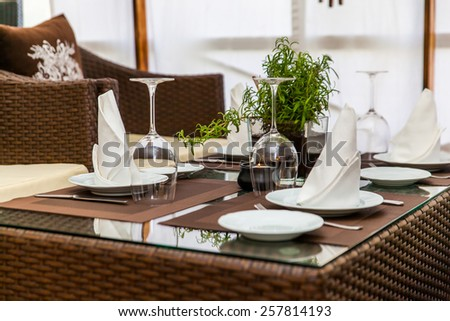 decorated table with glass goblet - stock photo